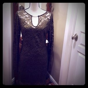 Black and gold lace cocktail lace over black slip